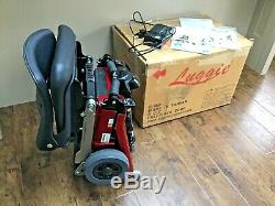 RED LUGGIE ELITE, MOBILITY SCOOTER, JUST OVER 2yrs OLD, CAN DELIVER