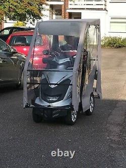 Royale four wheel Electric Mobility Scooter -silver, good condition with cover
